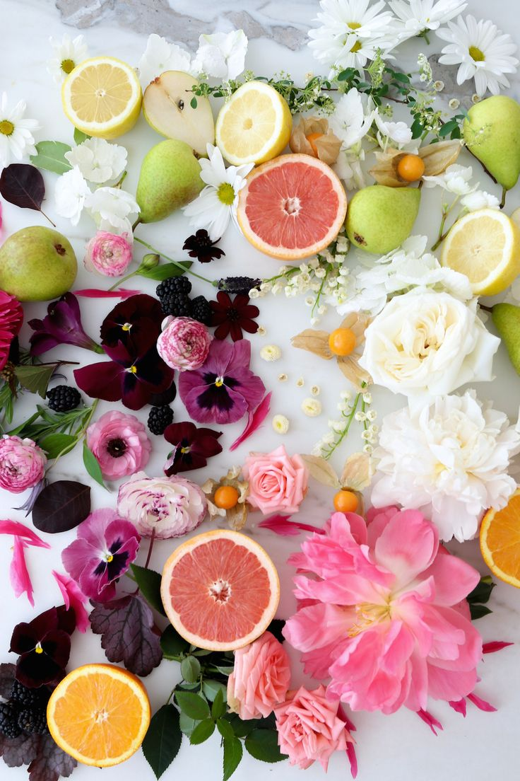 a summery assortment of fruit & blooms that will brighten any table