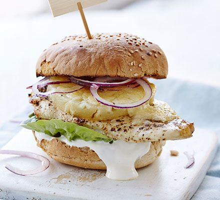 This tropical burger with soured cream, cheddar cheese and salad can be cooked come rain or shine - it's barbecue and grill friendly