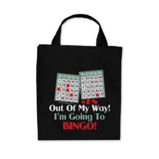 "Bingo Players Tote Bags Gifts for Bingo Lovers that is sure to put a smile on their faces! This Fun and funny gambling saying / quote design for Bingo Players: ""Out of My Way! I'm Going To BINGO!"" slogan humor. With bingo cards and red bingo daubers marker design."