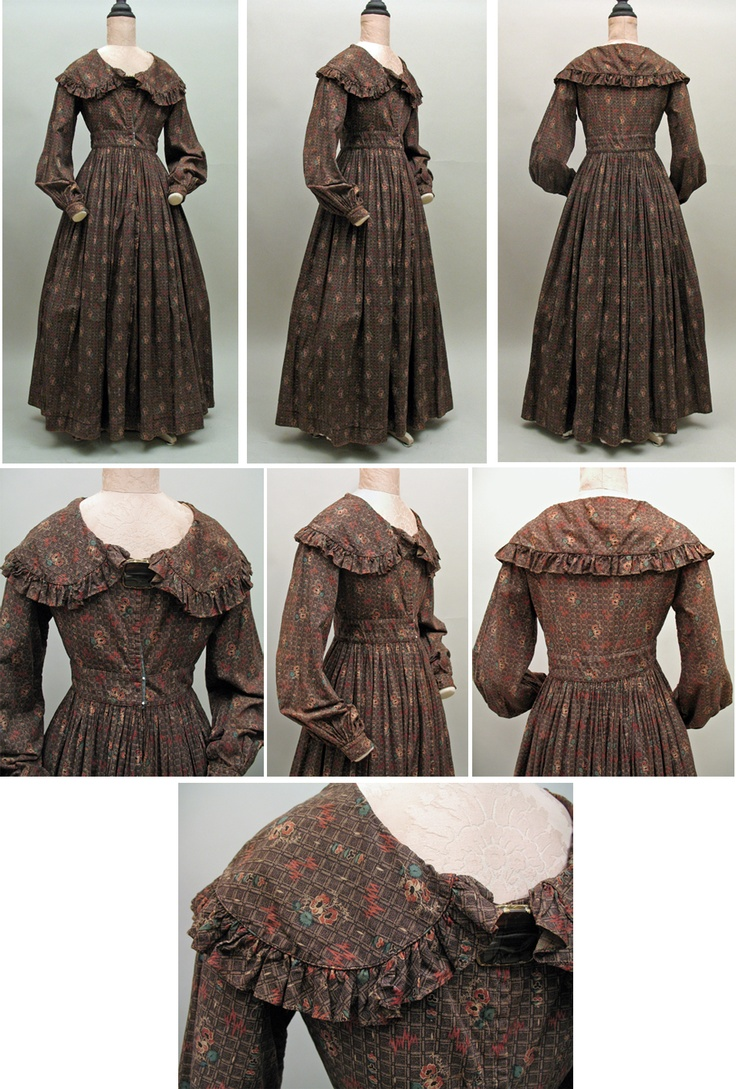 This warm brown cotton print robe,wrapper or day dress is ca. 1838 - 1842.The bodice has the open neckline and wide collar of the late 1830s,with a wide inset waistband and moderate bishop sleeves gathered into cuffs.Tiny piping is used to define the collar, cuffs and waist band.The fine print has red + green flowers + red zigzag lightening bolts on two tone brown plaid ground. The collar is edged with a self ruffle and the bodice is lined in cotton/linen. There are no front closures…