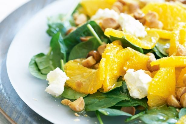 Baby spinach, orange and macadamia salad. Just a few ingredients are needed to create this tasty and eye-catching salad.