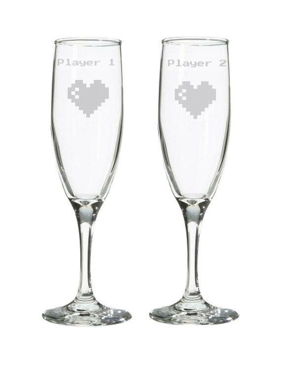 8 bit video game champagne flutes. Player 1 by HogglesHousewares at http://hoggleshousewares.storenvy.com/products/16698336-player-1-player-2-8-bit-heart-champagne-flutes-wedding-glasses-toasting-gl
