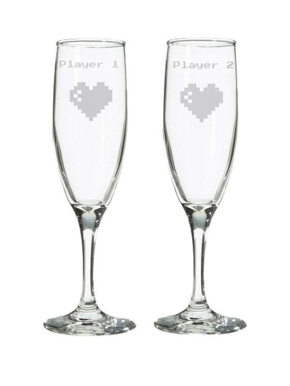 8 bit video game champagne flutes. Player 1 by HogglesHousewares at http://hoggleshousewares.storenvy.com/products/16698336-player-1-player-2-8-bit-heart-champagne-flutes-wedding-glasses-toasting-gl