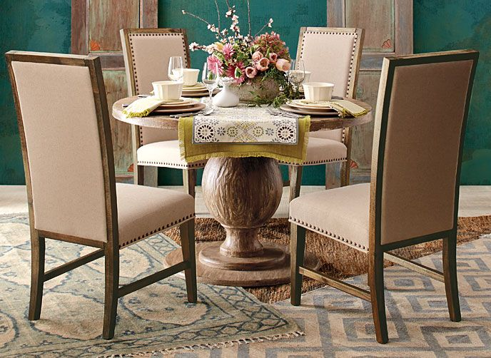 Lots of textures in this dining room--love the rugs
