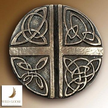 displays four Celtic designs, the design is based on the writings of Thilhard de Chardian, priest, scientist & prophet.