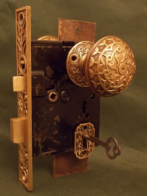 Antique Norwalk Hoofed Urn Bronze Entry Door Lock Set, c.1885. Take care when rebuilding,, that little spring will travel the distance of a room never to be found again!