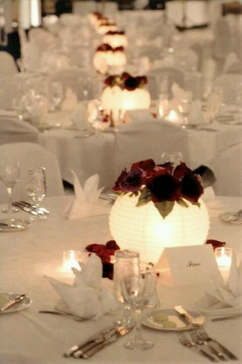 Paper lanterns as light up centerpieces inexpensive idea slip a vase in the middle of each lantern and add flowers of choice or just adhere silk flowers