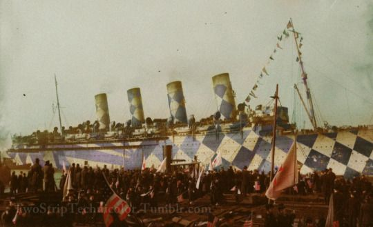 The RMS Mauretania in full WWI Dazzle camouflage, colorized by yours truly. Once again I went for an Autochrome-ish look. As far as I know, there are no known color photos of WWI era dazzle paint jobs.    (Original from Library of Congress)  #my edit#colorized#colorization#colorized photo#RMS Mauretania#WWI#World War I#dazzle camouflage#ship#ocean liner#troop ship#1910s#Cunard Line#Mauretania