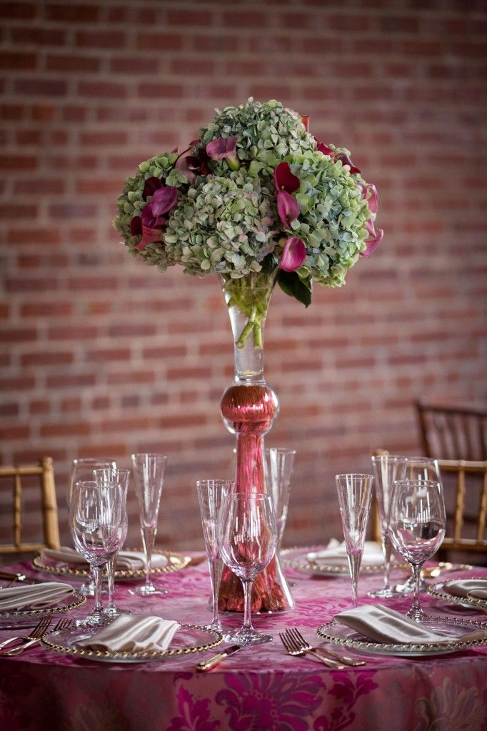 Double pilsner vase with mixed antiqued hydrangea and