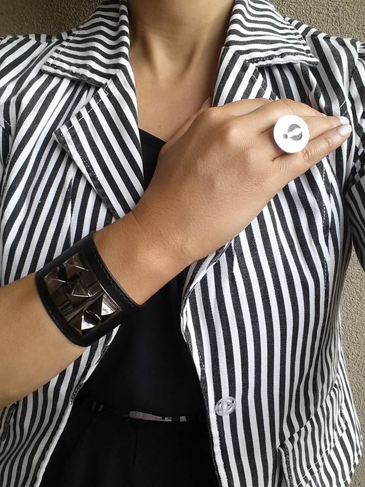 Perfect combination. Lee wearing striped jacket with polished logo ring.