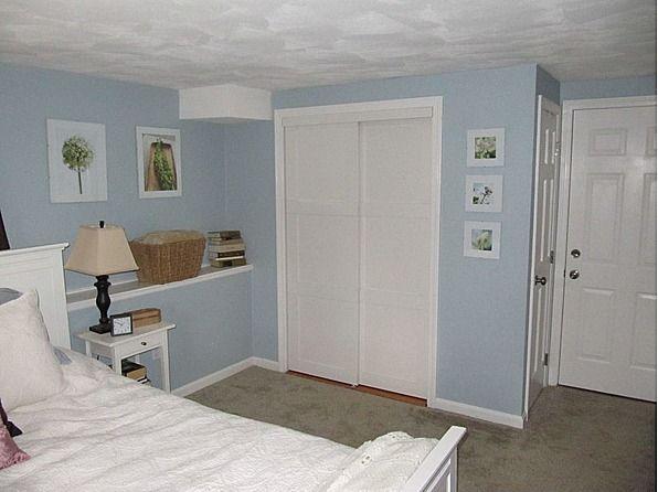 updated mirrored closet doors with custom white sliding