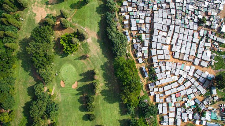 Striking Aerial Pictures of Limits Between Rich and Poor  Wealth and poverty sometimes cohabit just nearby in total indifference. The South African photographer Johnny Miller carried out the project Unequal Scenes in order to show this very real spectacle in his city of Cape Town on the southwestern coast of the country. A result that is striking due to its contrasts.             #xemtvhay