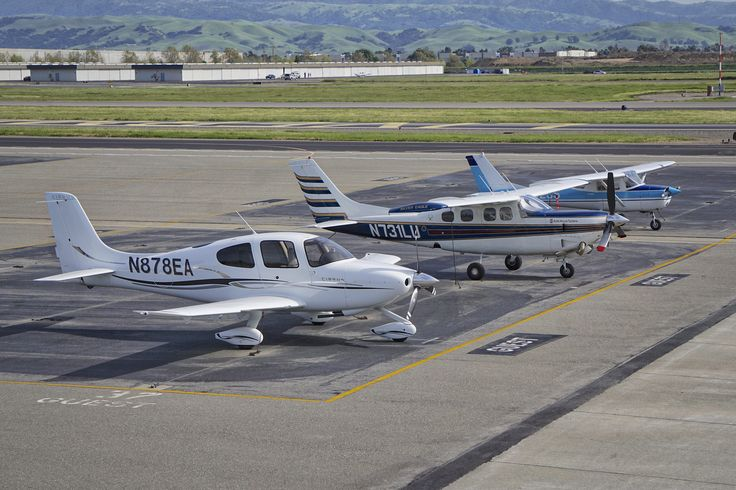 Cirrus SR20 N878EA and Cessna P210 N731LU. Livermore Airport. 2016.   Cirrus SR20, Cessna P210N, and Cessna 150 visiting Livermore airport.