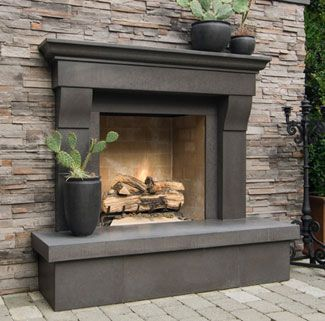 Raised Hearth and Mantle on Stone Fireplace. Box under hearth can be recessed and trimmed