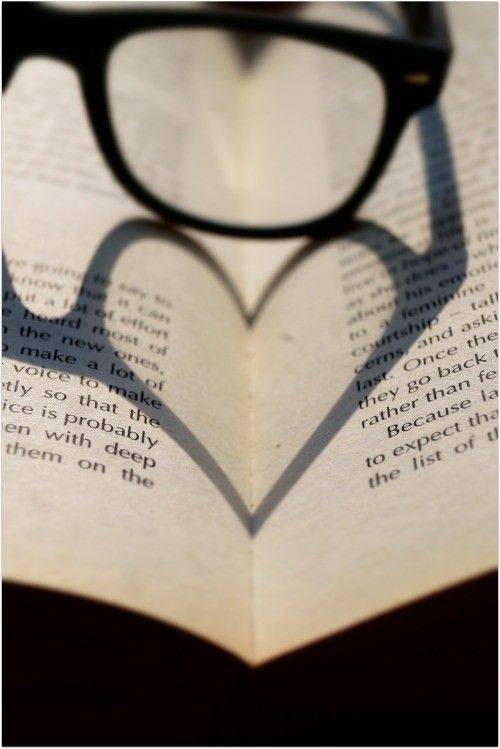 I really like how this photo makes a heart out of one frame of glasses. It really makes the picture pop and standout on the book. This photograph is very balanced. If you were to cut it right down the middle, you would have two sides that are perfect (symmetrical).