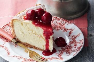 White chocolate cheesecake with sour cherry sauce