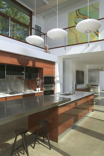 Kitchen of a Flatpak house with a gallery above