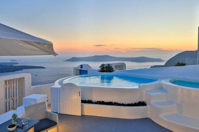 VISIT GREECE| Plunge pool overlooking the caldera on Santorini, Greek Islands.