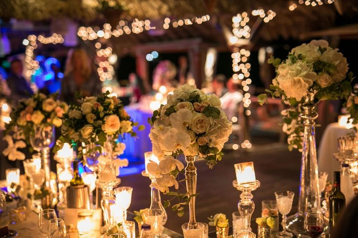 High flower compositions, full of orchids,hydrangeas and roses! The fairy lights in the background complete this magical setting!