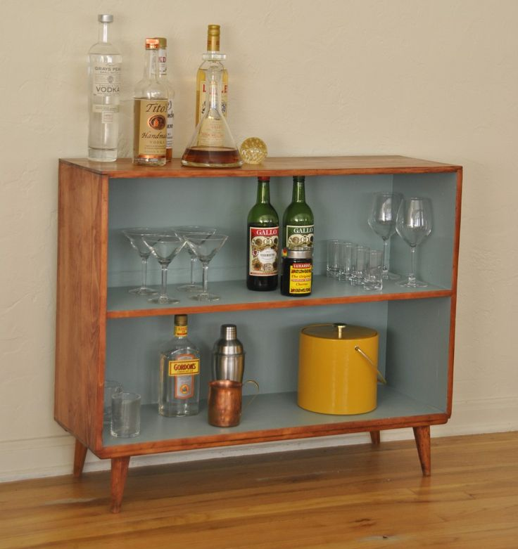 Length: 12″ Width: 36″ Height: 30″ This versatile two shelf piece can be used as a barcart, bookcase, or the perfect TV stand with plenty of extra storage space. With angled legs and unique blue interior, this piece is truly unique.*Shelves are 10″ each