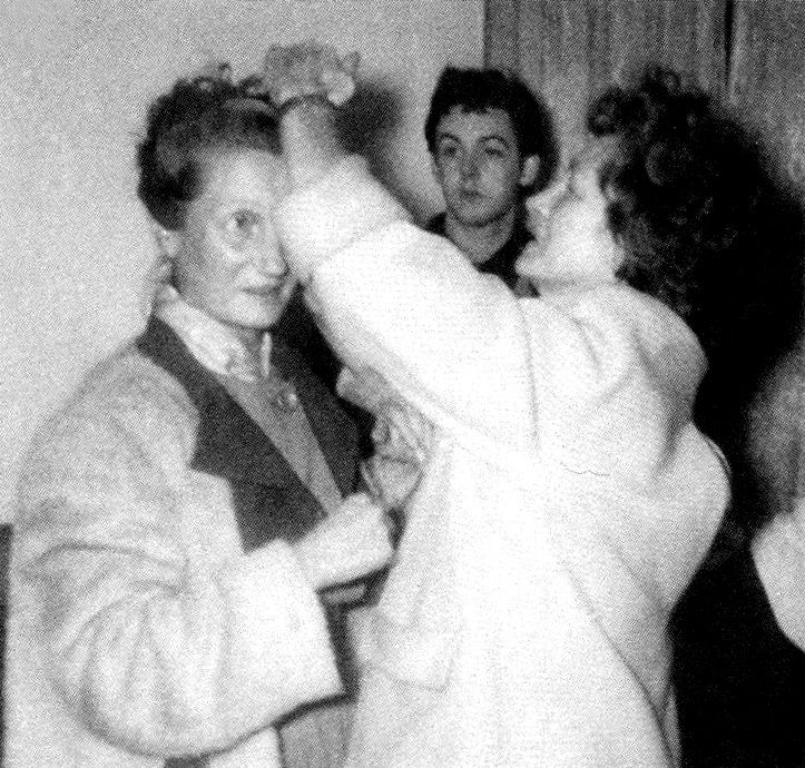 very young Paul McCartney with two of John Lennon's aunts (his mother ...