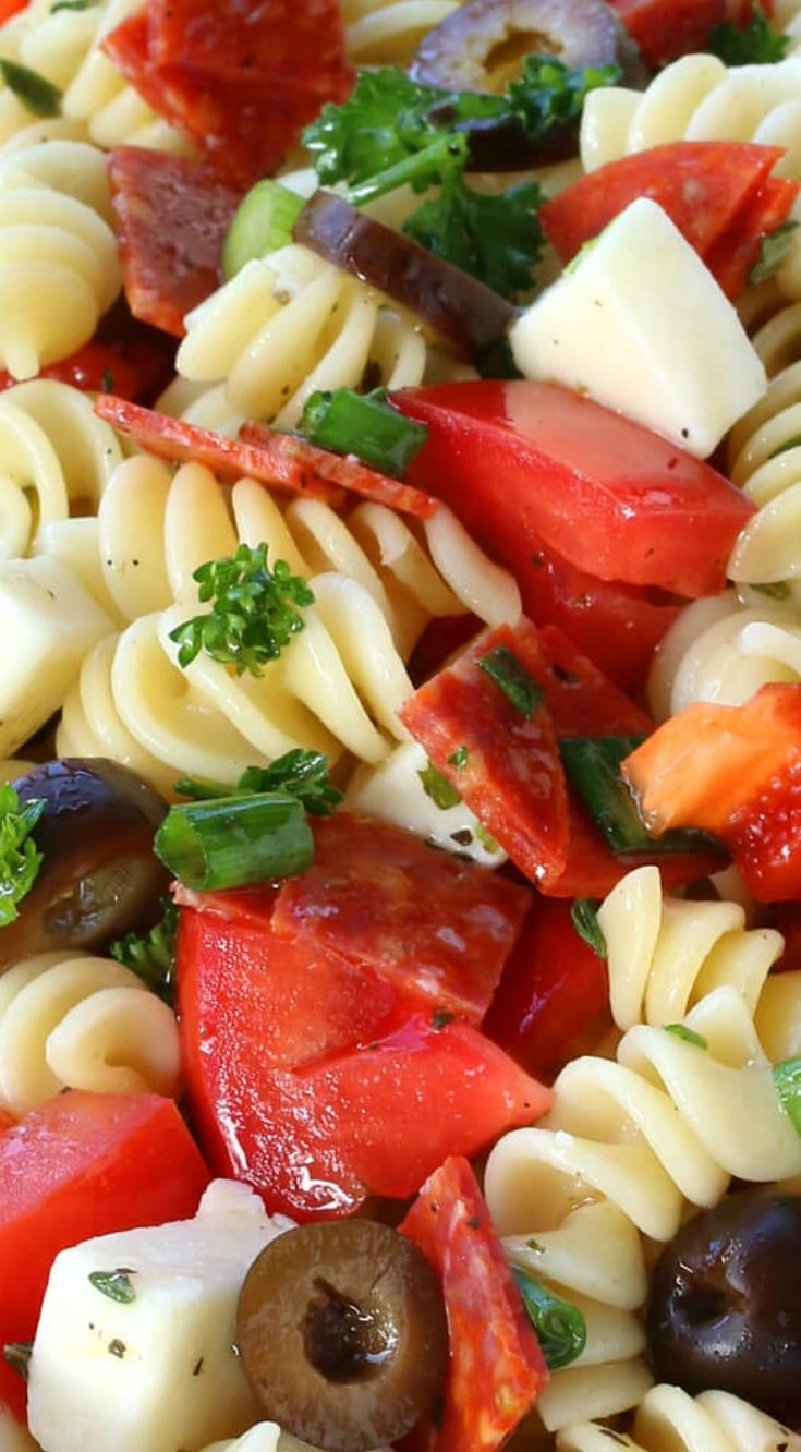 Pepperoni Pizza Pasta Salad ~ A colorful presentation and tastes delicious... Cheese, pepperoni, bell peppers, tomatoes and onions folded with pasta and tossed with a homemade Italian dressing.