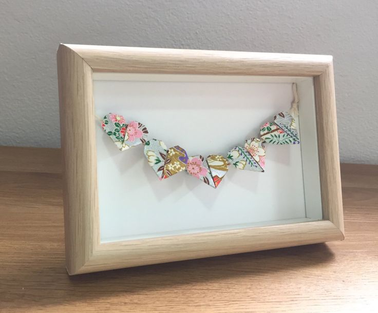 A personal favourite from my Etsy shop https://www.etsy.com/au/listing/502847538/framed-origami-hearts-heart-bunting