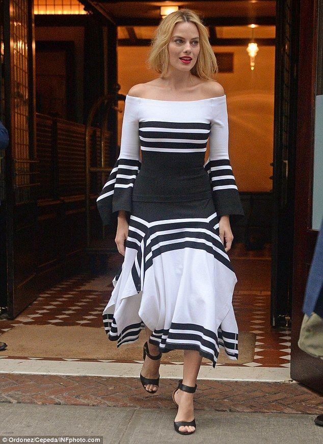 Classic look: Australian actress Margot Robbie was looking perfectly angelic as she left her hotel to promote Suicide Squad in New York City on Monday