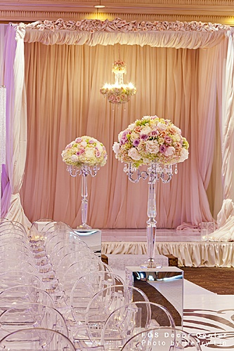 This ceremony decor it's just beautiful...the ghost chairs, hanging floral chandelier and acrylic floral stands