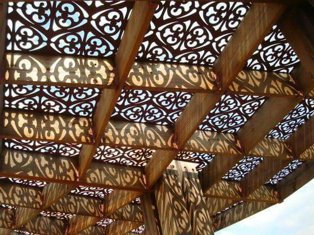 Decorative metal as a patio roof, love this idea.