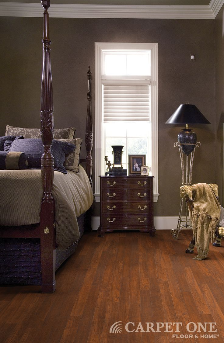 A beautiful traditional bedroom with laminate floors from Carpet One