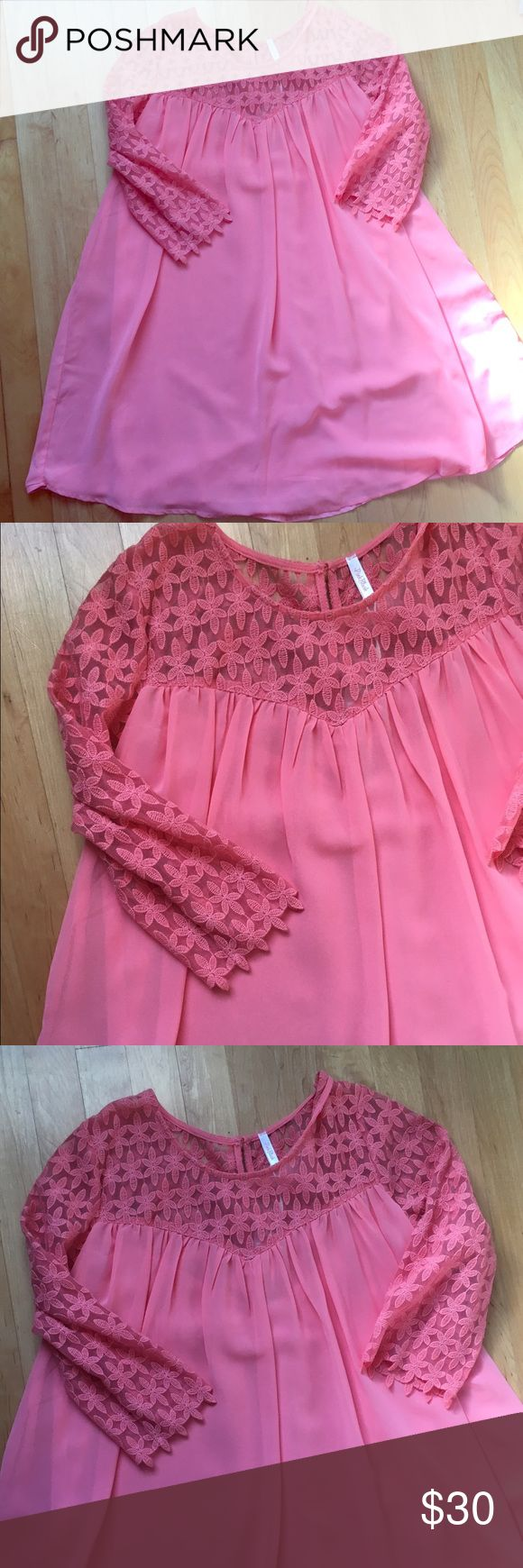 Pink Blush maternity tunic Beautiful feminine Pink Blush maternity tunic. Could be worn as a dress too. Lined sheer material with pretty floral cut out details. Pink Blush Tops Tunics