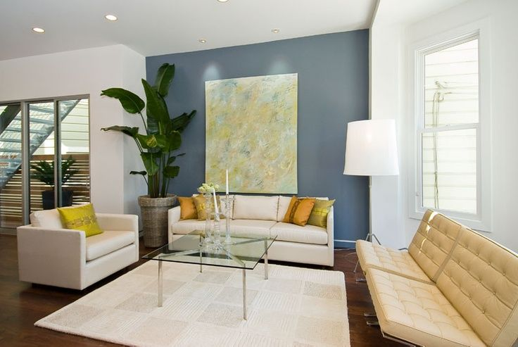blue accent wall in living room | Modern living room with blue accent wall