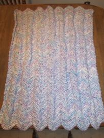 """Variegated light blues and light lavendar. Very soft!  Deborah Norville """"Serenity Chunky"""", 100% """"Fine""""Acrylic yarn.  Small """"Lap"""" afghan.  39"""" long x 32"""" wide.  FREE SHIPPING  jsrich1965@yahoo.com"""