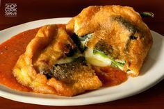 Chilli Rellenos: The chilli relleno, is a dish of Mexican cuisine that originated in the city of Puebla. It consists of a stuffed, roasted, fresh poblano pepper, sometimes substituted with non-traditional Hatch chile, Anaheim, pasilla or even jalapeño chili pepper See more at :http://www.shopcookserve.com/recipe/1224/Chilli-Rellenos