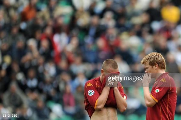 AS Roma's midfielder Daniele De Rossi and defender Arne Riise react during their team's Italian Serie A football match against Siena on October 5...