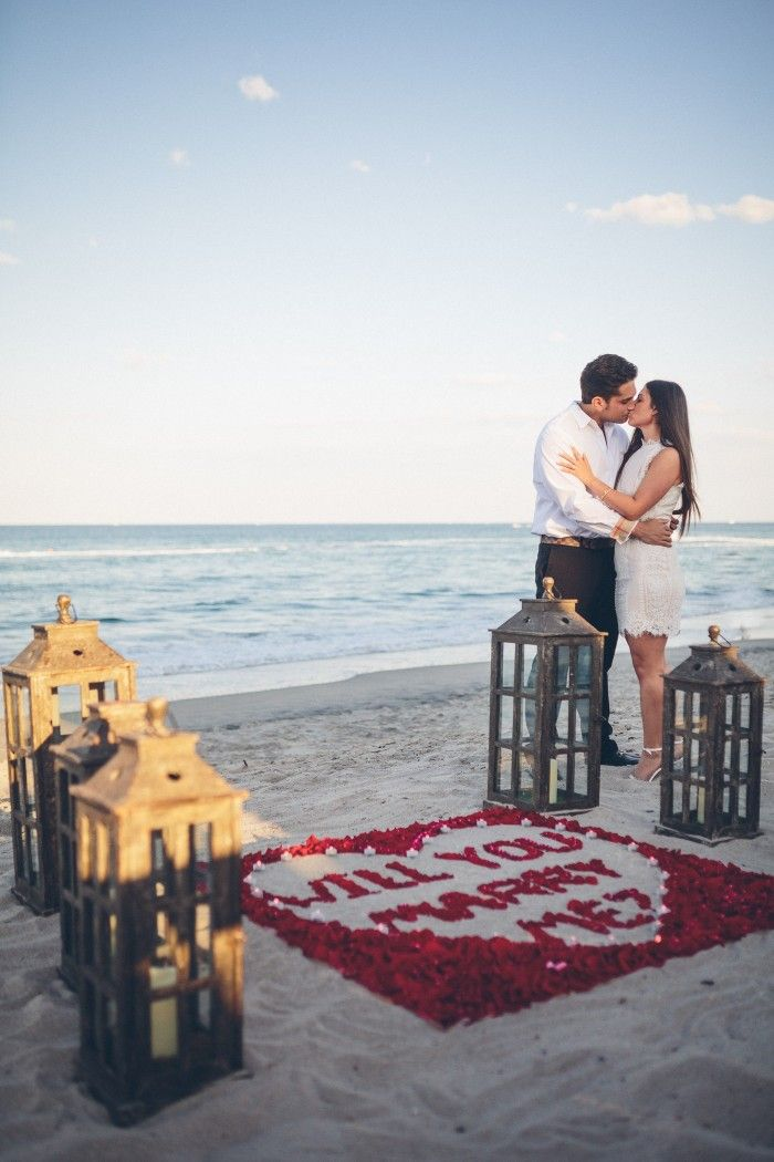 Such a romantic beach proposal, and he had a photographer there to capture the whole thing!