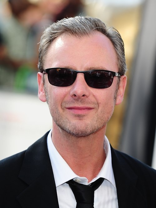 John Simm, combed, shaded, and ready to kick your ass.