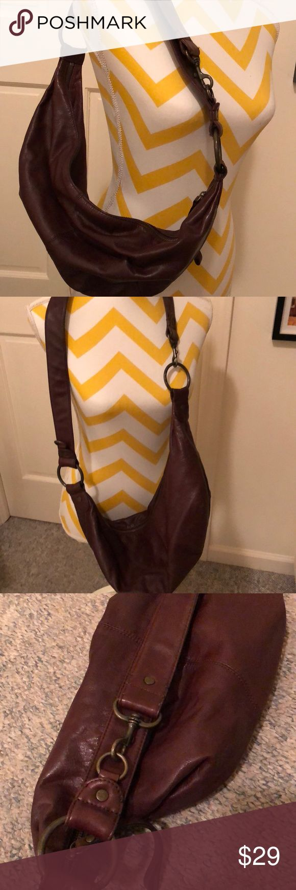 🔥REDUCED Brown leather GAP shoulder/crossbody bag Brown leather GAP shoulder/crossbody bag! With just one click of the claps this bag goes from a shoulder to a cross body bag. Crescent shaped and slouchy, perfect boho look! Soft, supple leather. It is 9 inches tall and 16 wide laying flat.  It did have a tag in the inside stating 'leather' but it used to drive me nuts so I cut it off 😬 about a year ago. No damage or stains. It's a beautiful functional bag!! Please ask all questions before…