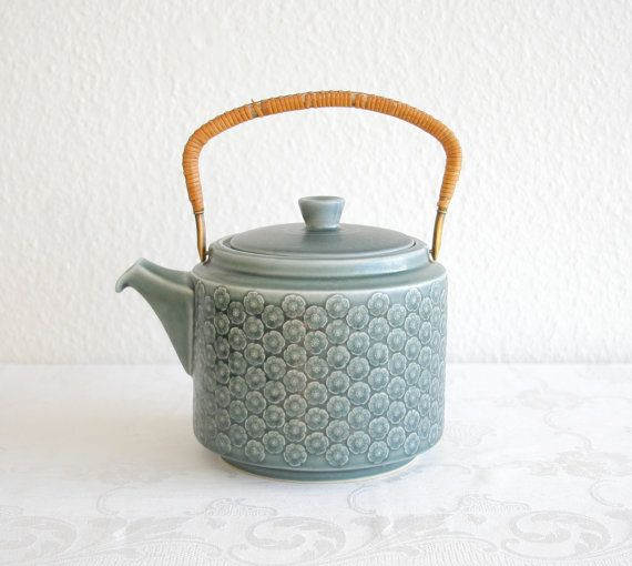 A teapot from the green Azur pattern, designed by Jens Harald Quistgaard and produced by Kronjyden, Nissen and Bing & Grondahl, made in Denmark.