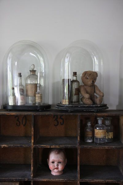 Brocante, déco brocante, anciens globes.....like the cloches....but the doll head is freaky..