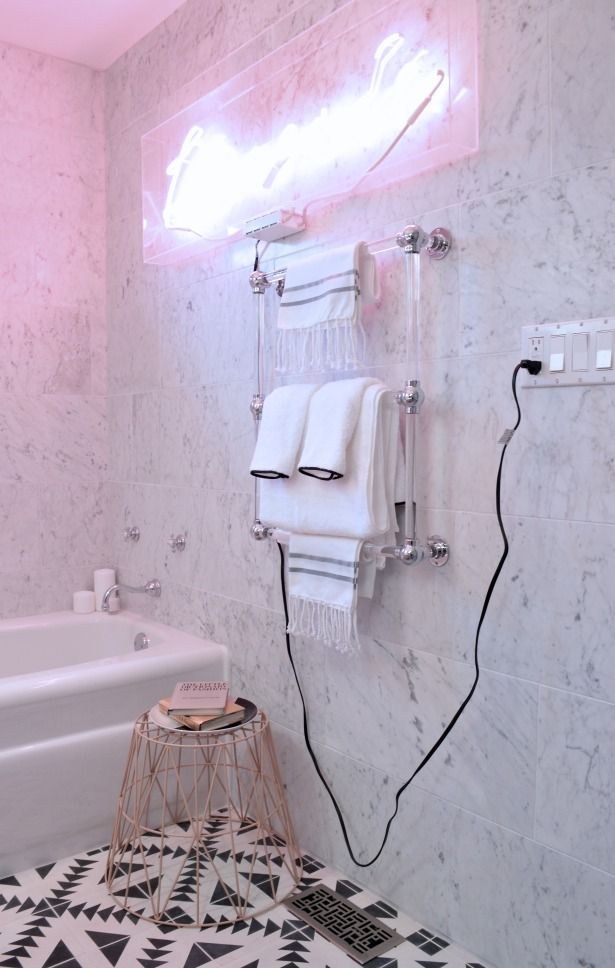neon sign in bathroom white marble bathroom
