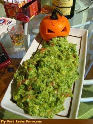 Guacamole and a pumpkin with his mouth open make gross but appetizing halloween food.