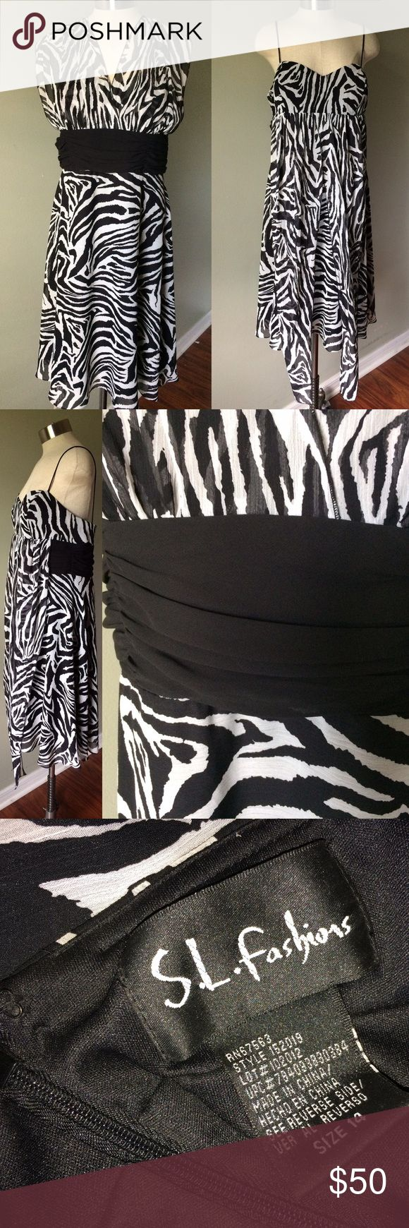 """▪️◽️Zebra Print Dress◽️▪️ Worn only once. Has been stored with care and is in excellent condition. Purchased from Group USA.  Zipper is functional. Dress can be tied multiple ways. Measurements: 32"""" Long, 17"""" Bust, 17.5/18"""" Waist, Straps 16.5"""" and Two Ties 37"""". If you have any questions feel free to ask! Happy Poshing 😊💕💕 S.L. Fashions Dresses"""