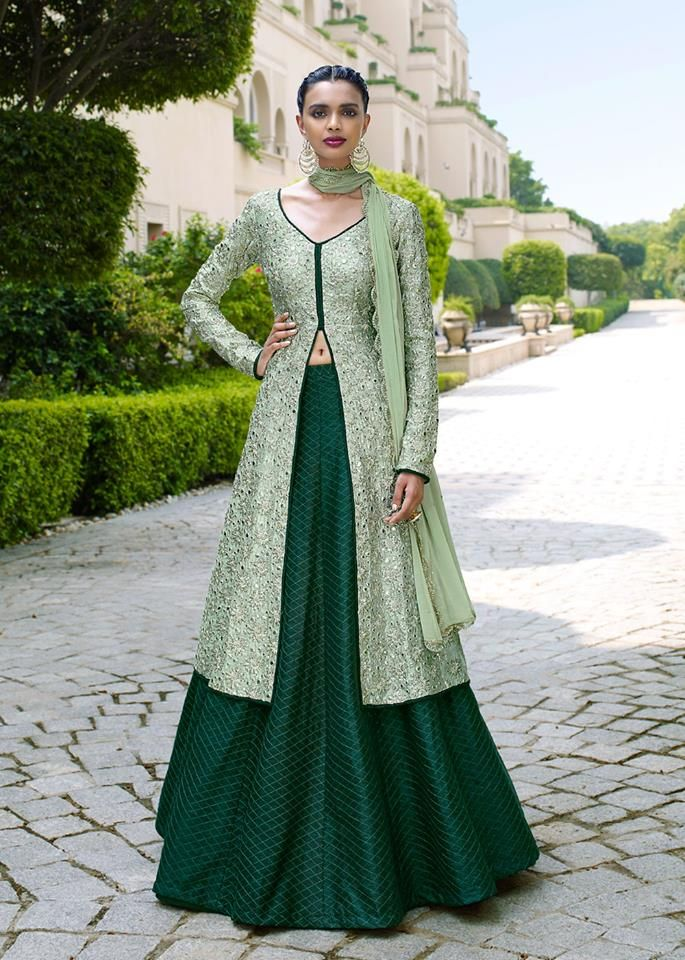 Green bhagalpuri silk lehenga. Green bhagalpuri silk long length choli detailed with stone, mirror effect and zari embroidery work and green chiffon dupatta are available with this