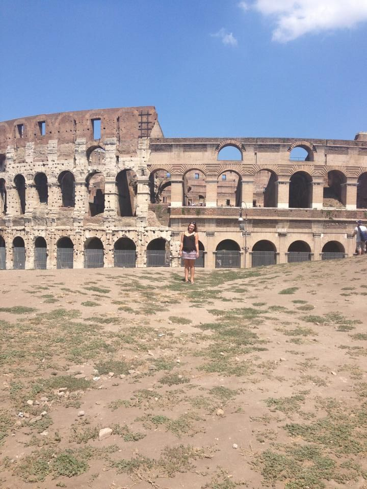 Here is another shot of little me standing in front of the massive and ancient collesium