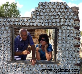 opal-fields-humor-Renate' and Peter at the tin can house - Lightning Ridge - One example of some the really funny things people build at the opal fields