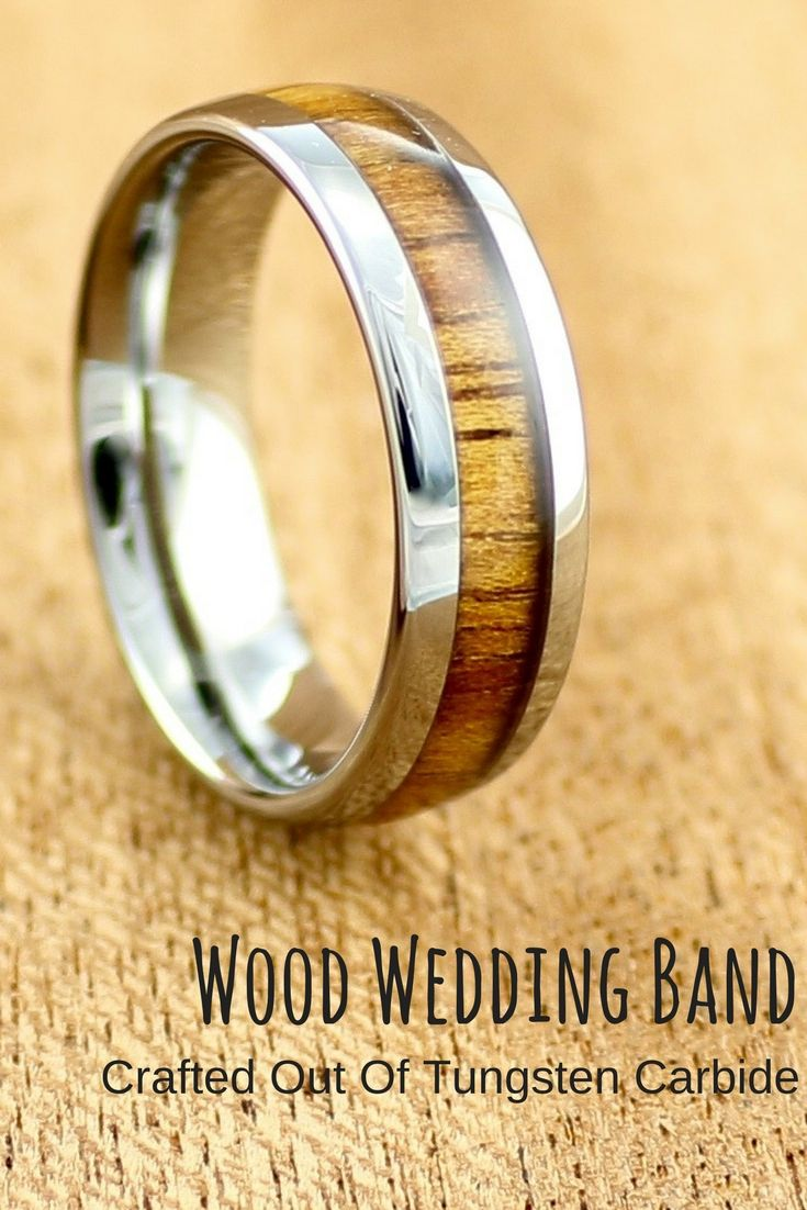 Tungsten wood wedding band inlaid with genuine koa wood. The tungsten has been designed with a high polish finish. This makes the perfect mens wood wedding ring.