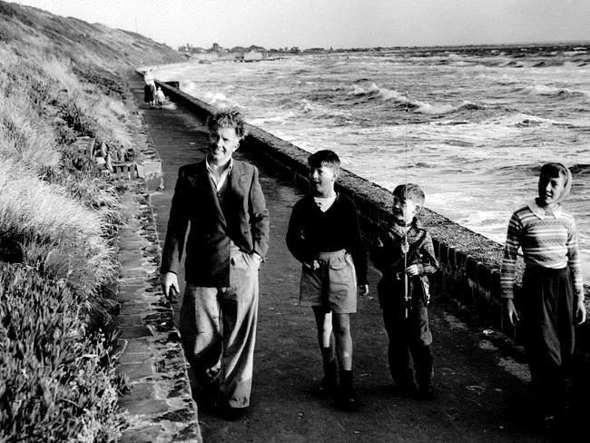 31 December 1953: Bill Young, Brian Collins, David Young and Judith Young enjoy a stroll