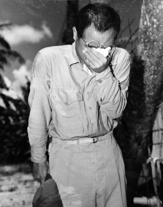 Japanese prisoner of war listening to Emperor Showa's surrender announcement Guam 15 August 1945.